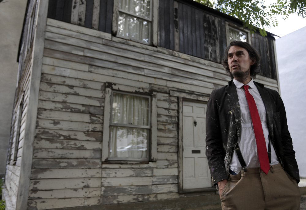 American artist Ryan Mendoza poses in front of the rebuilt house of Rosa Parks which he saved and moved to Berlin.