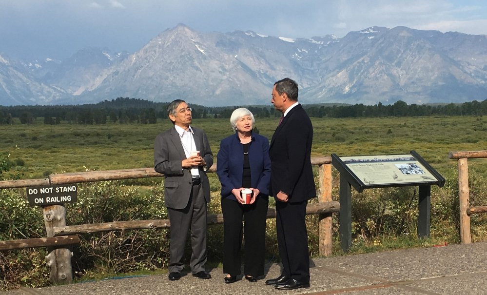Federal Reserve Chair Janet Yellen, center, confers with Mario Draghi, right, head of the European Central Bank, and Haruhiko Kuroda, head of the Bank of Japan, during a break at an annual conference Friday at Jackson Hole, Wyo.