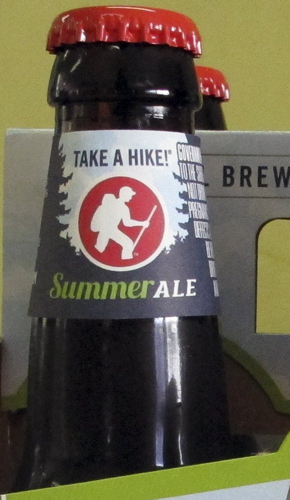 "A label with the slogan ""Take a Hike"" wraps the neck of a Long Trail Brewing Co. beer at Elm Street Market in Montpelier, Vt., on Friday."