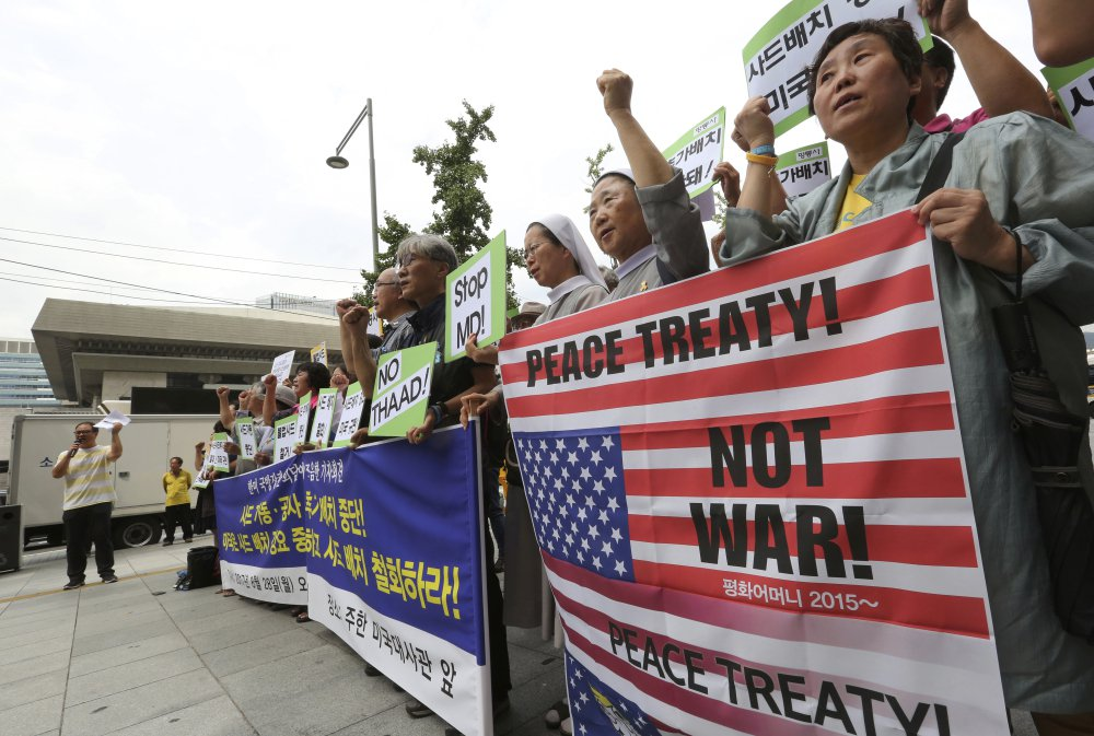 South Korean protesters stage a rally against the deployment of an advanced U.S. missile defense system called Terminal High-Altitude Area Defense, or THAAD, near the U.S. embassy in Seoul, South Korea, on Monday. North Korea fired several rockets into the sea Saturday in the continuation of its rapid nuclear and missile expansion, prompting South Korea to press ahead with military drills involving U.S. troops that have angered Pyongyang.