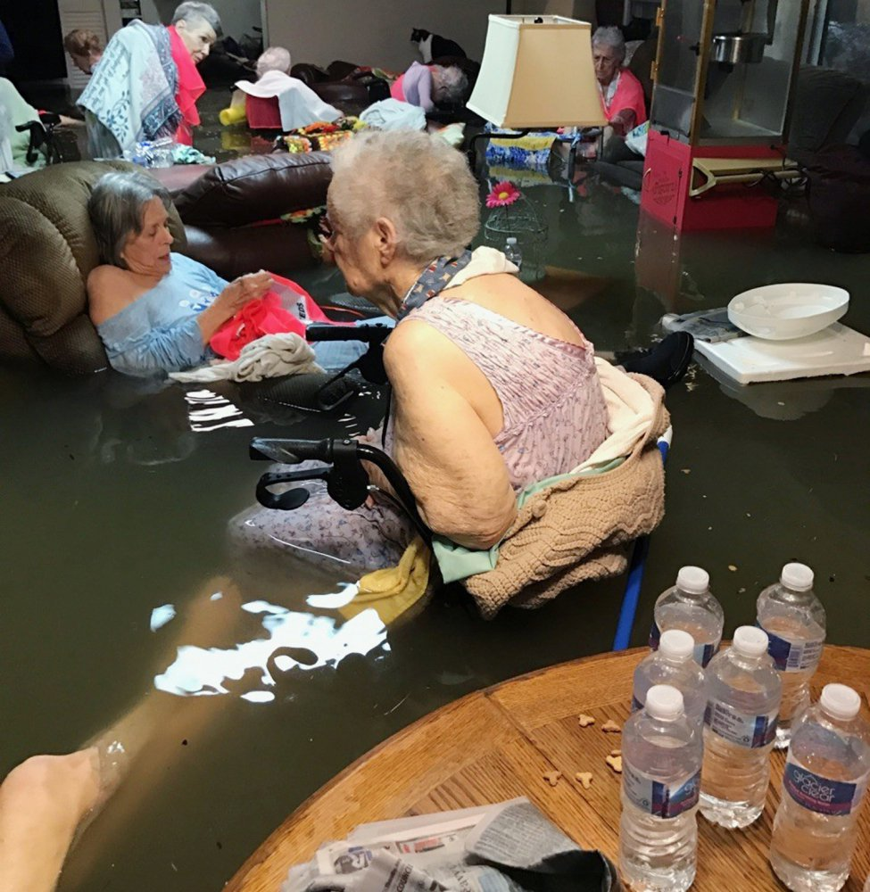 Residents of the La Vita Bella nursing home in Dickinson, Texas, sit in waist-deep flood waters caused by Hurricane Harvey. Authorities said all the residents were safely evacuated from the facility on Monday.