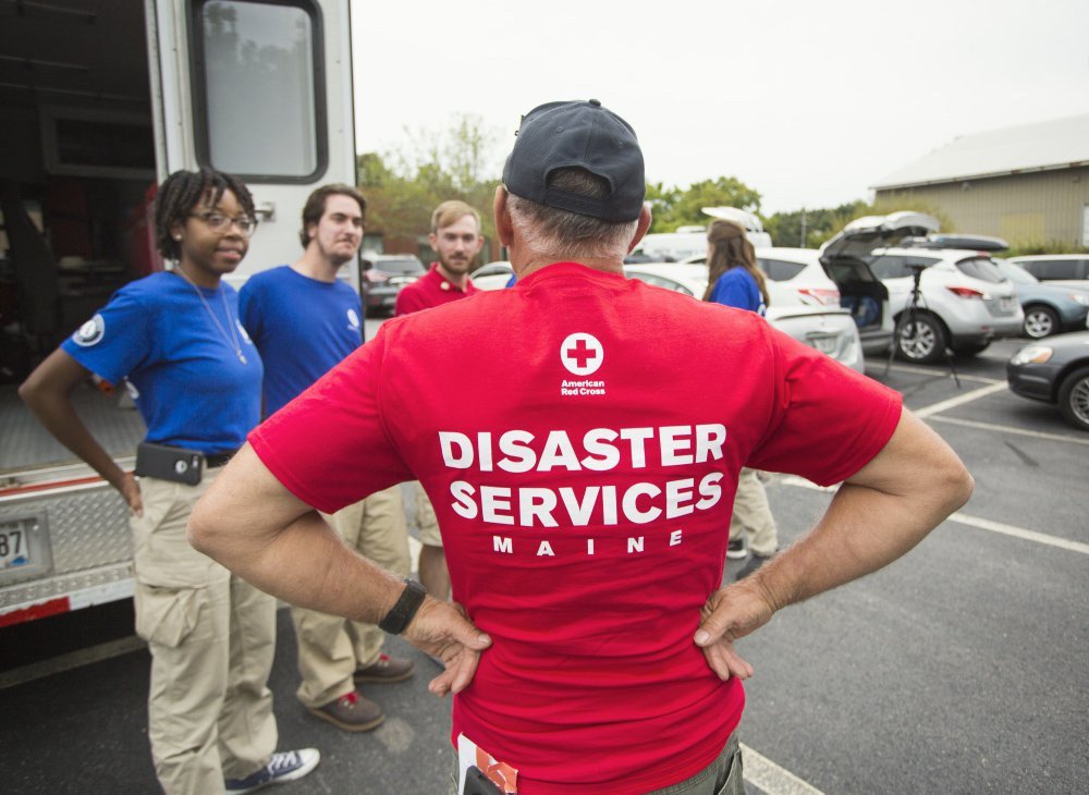 Red Cross volunteer Bill Thomas speaks to FEMA Corps workers in Portland.