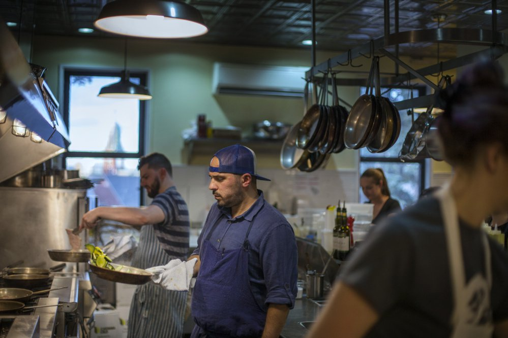 Chef Anders Tallberg works in the kitchen at the newly reopened Roma Cafe in Portland.