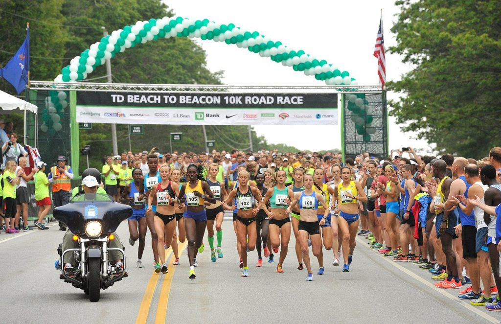 The elite women runners cross the starting line at the Beach to Beacon on Aug. 5, 2017.