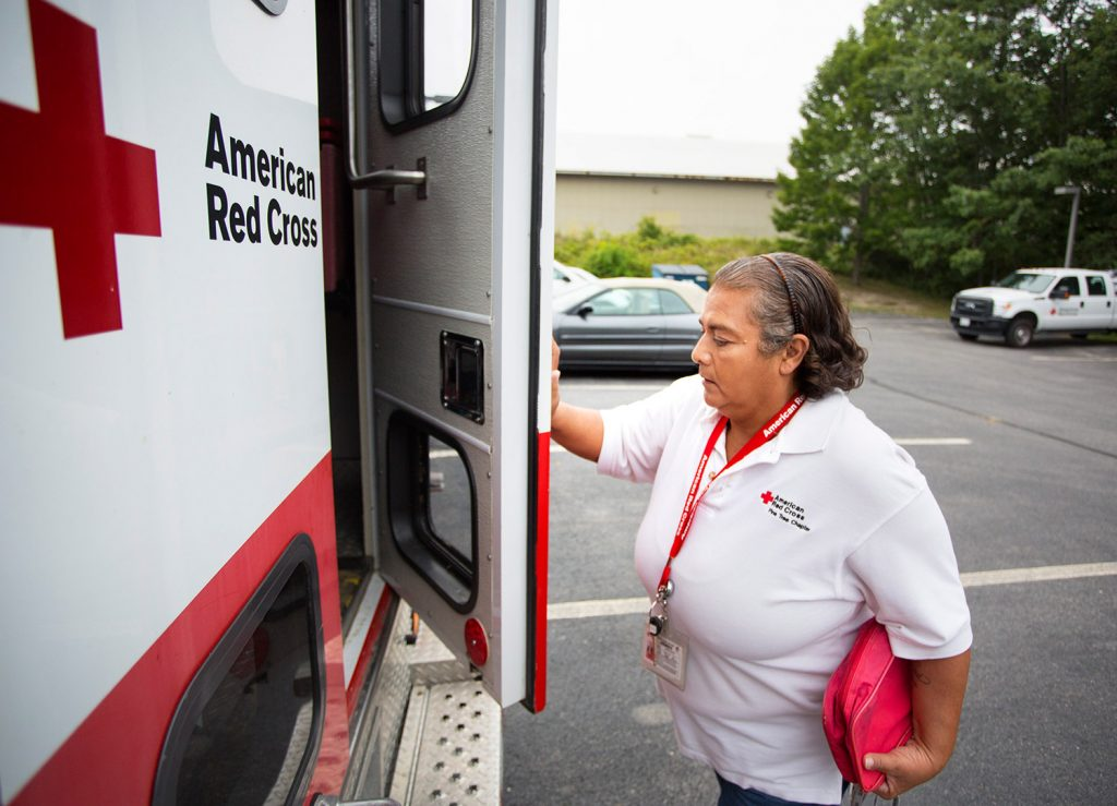Red Cross volunteer Corina Hamlin of Brownville prepares to head south from Portland with another volunteer to help victims of Hurricane Harvey. They  delivered a Red Cross emergency response vehicle, an ambulance-like truck that can carry food, cots and other supplies into disaster areas.