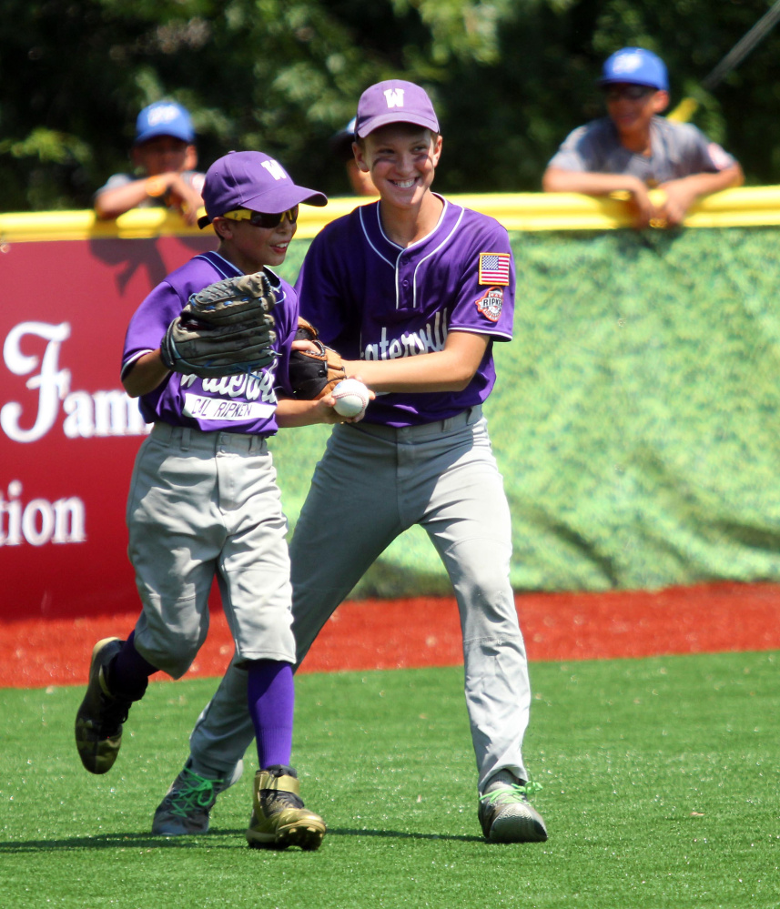 Waterville left fielder John Nawfel, left, gets congratulated by center fielder Spencer Brown after making a catch to end the third inning in a Cal Ripken 11U New England regional quarterfinal game Tuesday against Barrington, New Hampshire at Purnell Wrigley Field in Waterville. Waterville won 8-1.