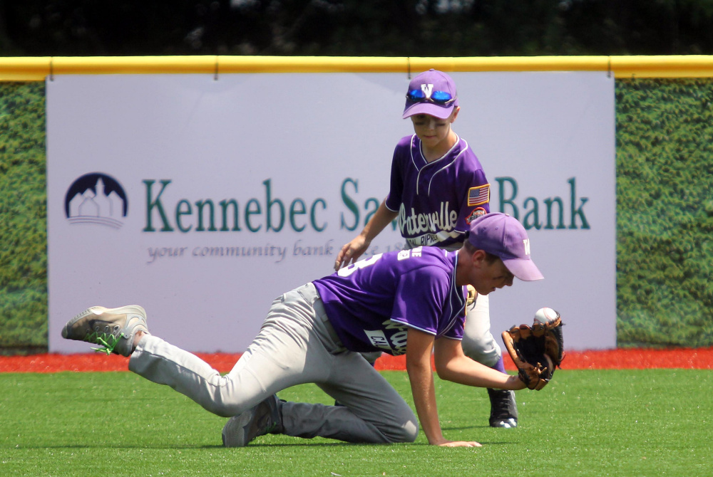 Waterville center fielder Spencer Brown makes a snow-cone catch in front of Ben Foster during a Cal Ripken 11U New England regional quarterfinal game Tuesday against Barrington, New Hampshire at Purnell Wrigley Field in Waterville. Waterville won 8-1.