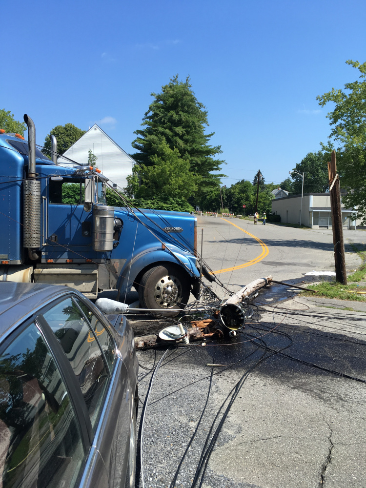A tractor-trailer snagged power lines on Maple Street in Waterville, breaking two utility poles, sending a transformer crashing to the pavement and cutting power to about 280 Central Maine Power Co. customers.