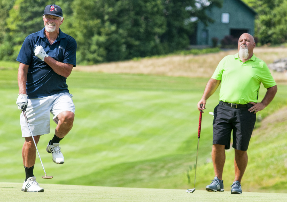 Bill Lee, left, grimaces after just missing a putt as Ray Haskell watches during the Ray Haskell Ford MLB Players Alumni Association golf fundraiser Thursday at Belgrade Lakes Golf Course in Belgrade.