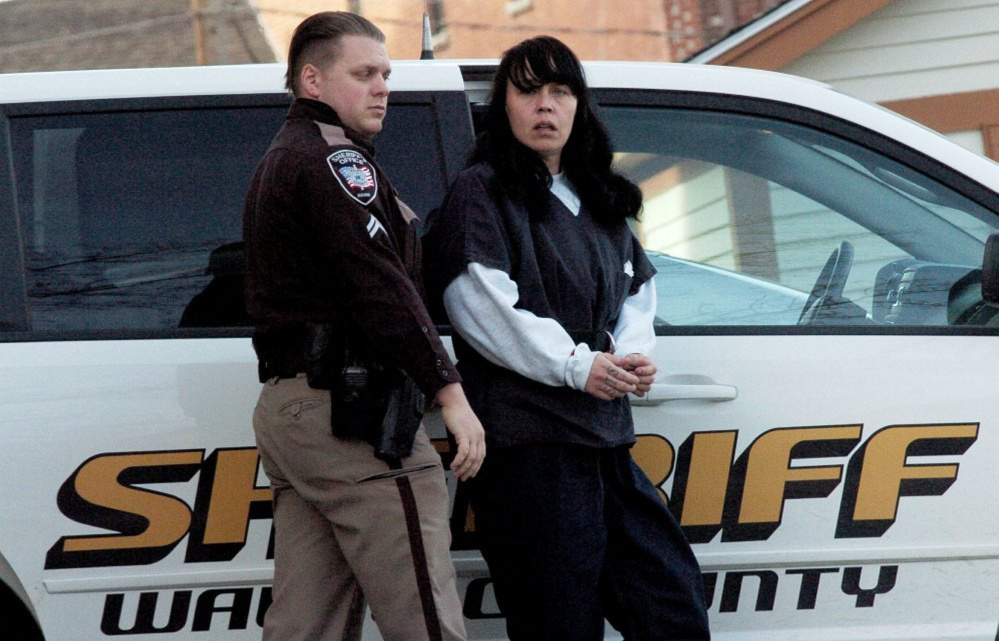 Miranda Hopkins, of Troy, is led into Belfast District Court on Jan. 17 for an initial appearance in connection with the death of her 7-week-old son.