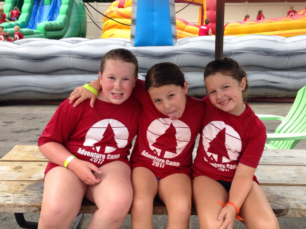 Campers at Adventure Camp in Waterville spent Aug. 4 at Roy's Inflatable Water Park in Madison. From left are Sarah True, of Cornville, Hannah Gurney MacLaughlin, of Waterville, and Lily Lamport, of Waterville.