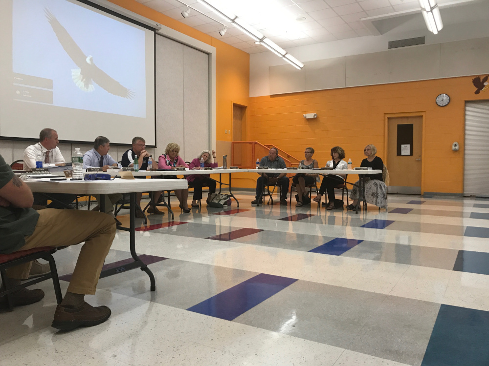 The RSU 18 school board discusses a motion related to a proposed $13.9 million facilities bond on Wednesday in Oakland.