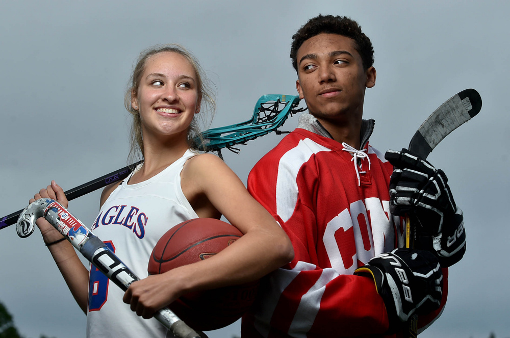 Messalonskee Multisport Athlete Ally Turner Left And Cony High School Graduate Former Hockey Player Cam Wilson Pose At Thomas College In Waterville On