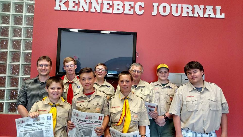 Front, from left, are Ben Pentilla, Braden Mayo and Harrison Quimby. Back, from left, are Kennebec Journal/Morning Sentinel Managing Editor Scott Monroe, Thomas Robinson, Ben Lamontagne, Scout Leader Ronald Mansir, Jake Viger and Zach Truman.