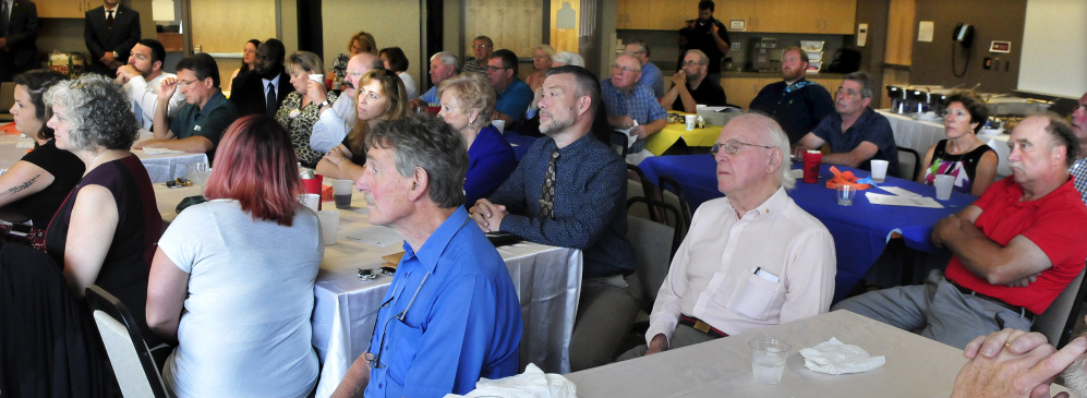 Members of the Waterville Rotary club listen to guest speaker Gov. Paul LePage during a luncheon on Monday.