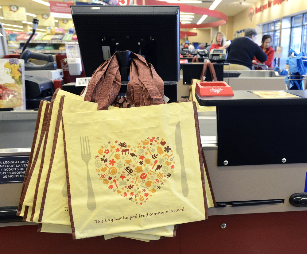 Portland's Hannaford stores began charging for plastic bags after a plastic bag ordinance went into effect in April 2015. The stores gave out these reusable bags to customers.