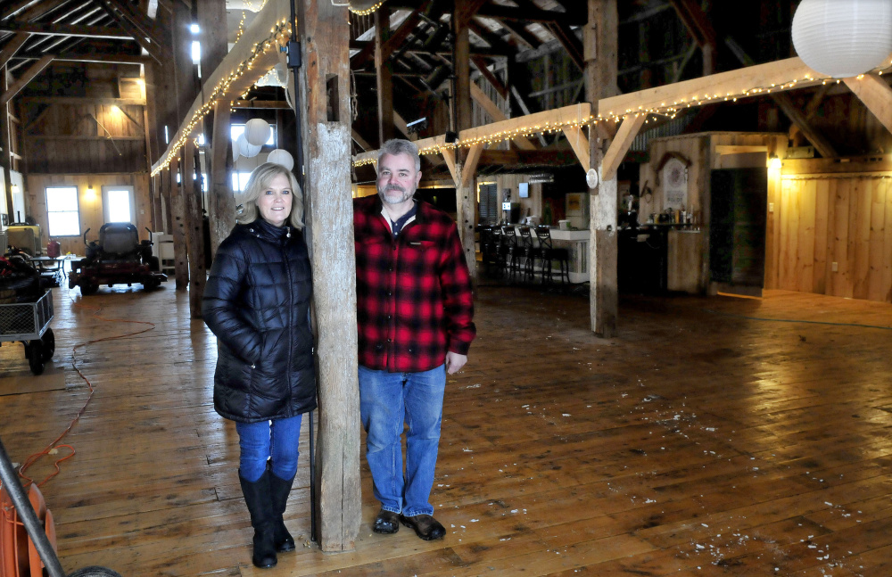 Cathy and Parris Varney stand inside their renovated barn in China on Feb. 9, 2017. A neighborhood association is insisting that the town code enforcement officer should take action against the Varneys over reports of them hosting events inside the barn without a town permit.