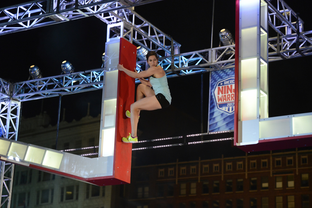 Jesse Labreck hangs on to an apparatus during her run at the