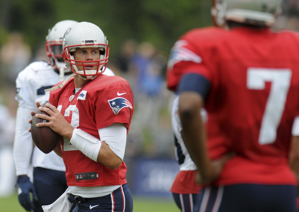 New England Patriots quarterback Tom Brady looks to throw during a joint practice with the Houston Texans on Wednesday in White Sulphur Springs, West Virgina.