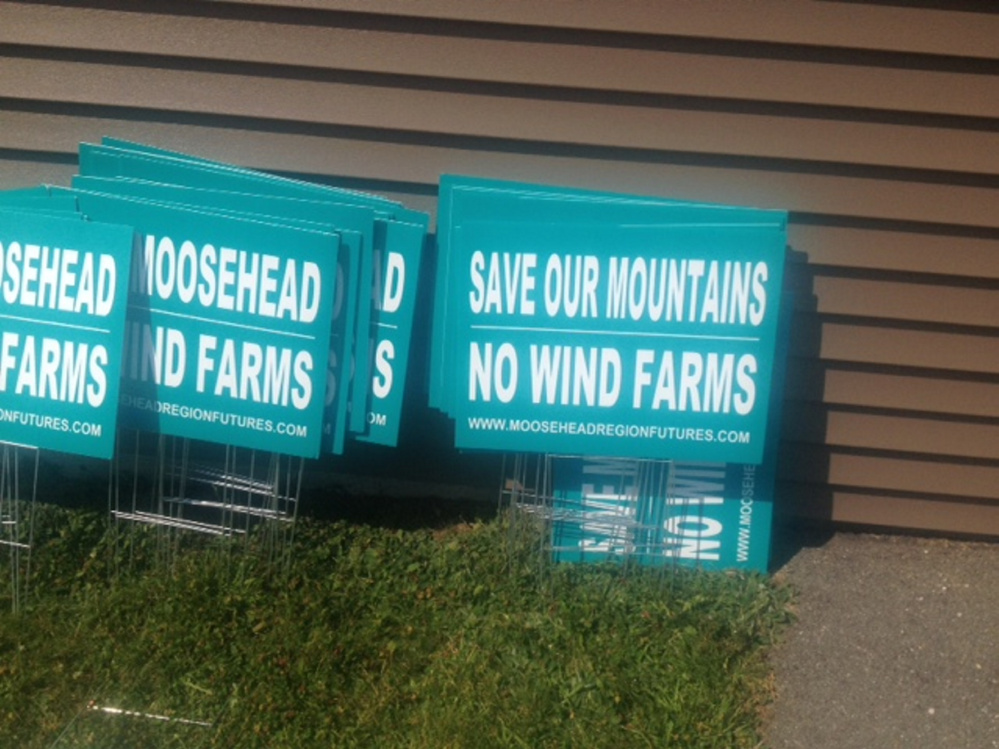 Anti-wind turbine signs are stacked up outside Rockwood Community Center on Wednesday before Somerset County commissioners heard concerns from a group over more turbines that could come to the area.
