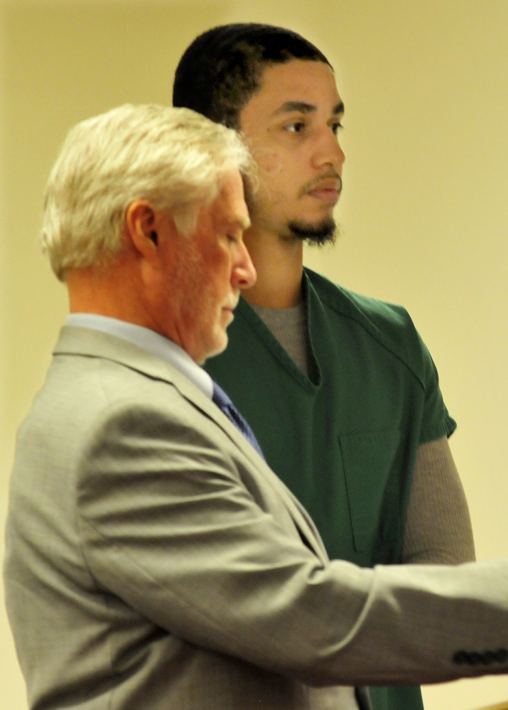 Defendant Dreaquan Foster, right, attends an arraignment hearing on charges related to a Sidney home invasion last spring at the Capital Judicial Center in Augusta on Thursday. At left is his attorney, Thomas Tilton.