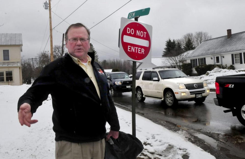 Skowhegan Road Commissioner Greg Dore stands at the intersection of Gem Street and North Avenue in Skowhegan, where Gem Street became a one-way road on April 17. The signs since have been taken down.