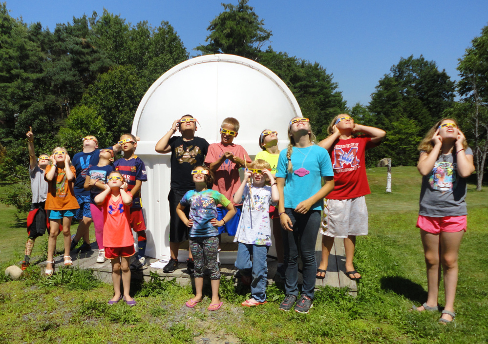 L.C. Bates Museum astronomy campers test their solar-viewing glasses in preparation for the partial eclipse on Monday.