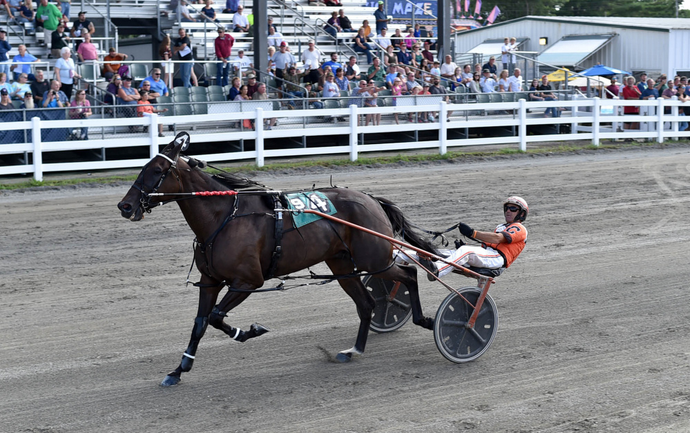 Drew Campbell crosses the finish line driving JJs Jet to win the Hight Invitational at the Skowhegan Fair on Saturday.