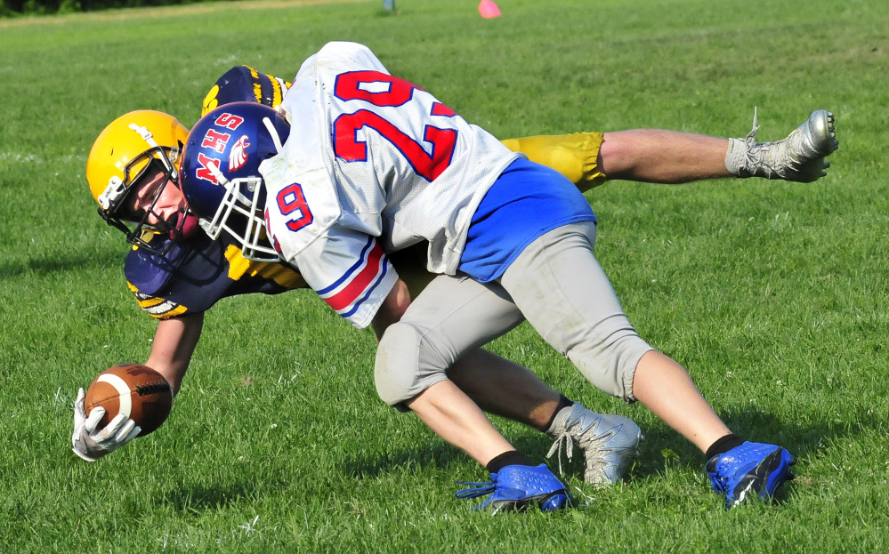 Messalonskee's Josh Goff takes Mt. Blue's Randy Barker down during a scrimmage Monday in Oakland.