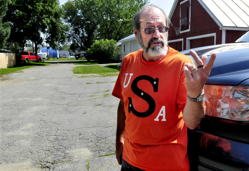Rick Hunter, with Moody Street stretching out behind him on Tuesday, is one of the street's residents who has joined his neighbors in a legal bid to have the street declared a public way and maintained by the town of Skowhegan.