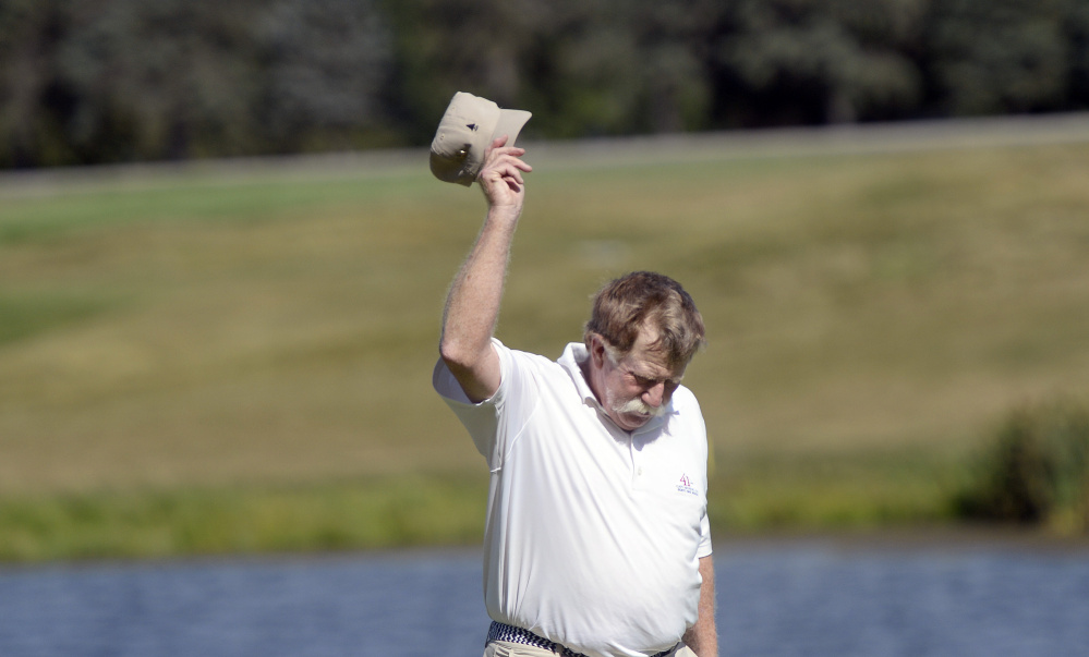 Manchester native Mark Plummer tips his hat after winning the Maine Senior Amateur on Wednesday at the Falmouth Country Club.