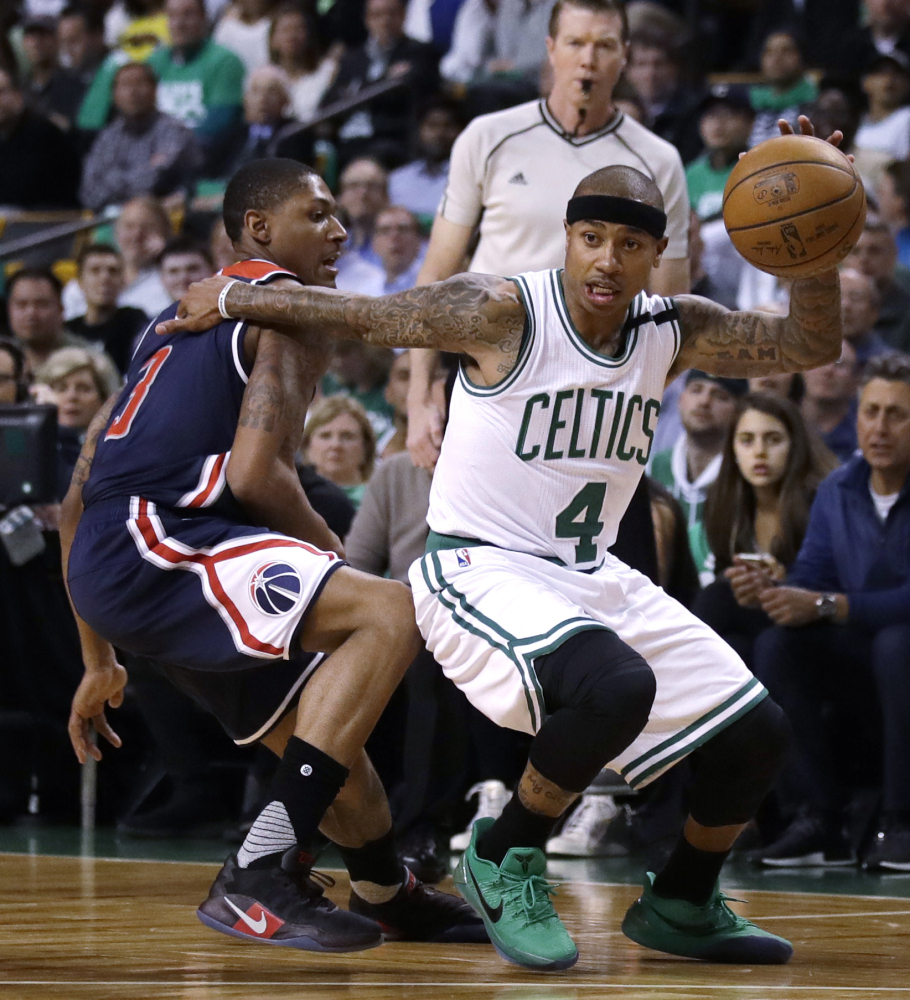 Boston Celtics guard Isaiah Thomas drives to the basket during the first quarter of a second-round playoff series game in Boston.