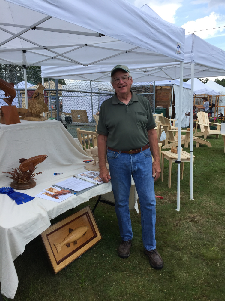Contributed photoJohn Hooper won first place in the 3-D category at the Art in August artists and artisans exhibition in Oquossoc Park on Aug. 3.