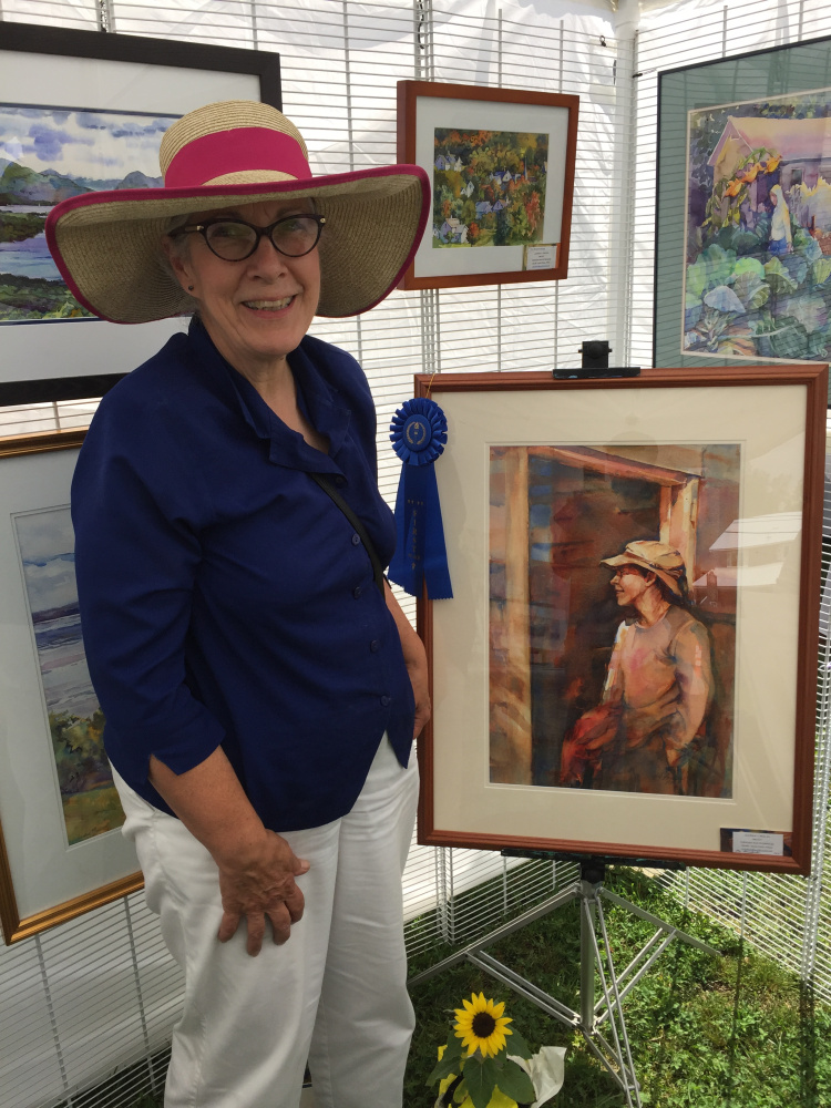 Sandra Pealer won first place in the 2-D category at the Art in August artists and artisans exhibition in Oquossoc Park on Aug. 3.