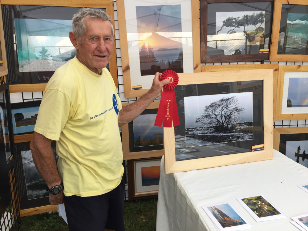 Contributed photoWalter Mularz placed secon in the 2-D category at the Art in August artists and artisans exhibition in Oquossoc Park on Aug. 3.
