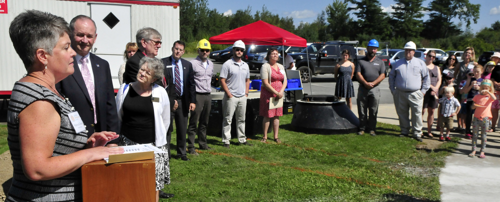 Kennebec Montessori Head of School Rebecca Green and other officials address parents and students during a groundbreaking ceremony for the USDA financed expansion project at the Fairfield school Thursday. Beside Green is Tom Higgins of the Maine USDA office.