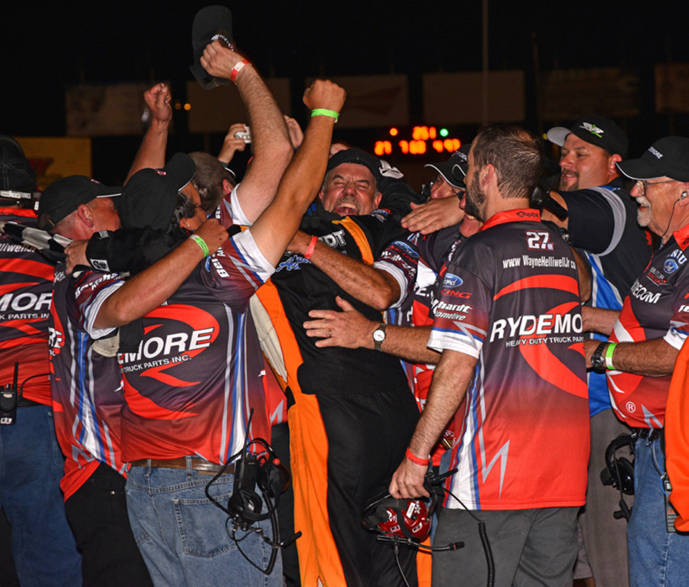 Wayne Helliwell Jr. leaps into the arms of his team after winning the Oxford 250 last August at Oxford Plains Speedway.