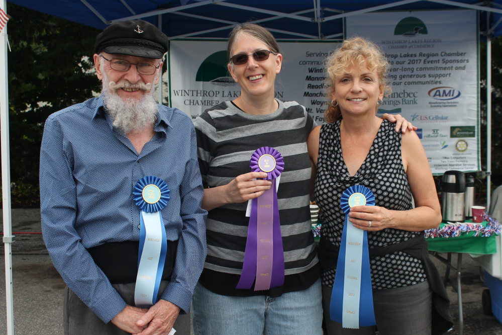 The 30th Annual Winthrop Sidewalk Art Show winners, from left, are Marvin Jacobs, of Belmont, Janyce Boynton, of Old Town, and Diane Harwood, of Winthrop.