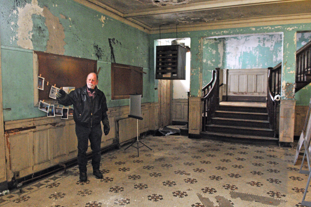 Richard Parkhurst, a member of the Colonial Theatre's board of directors, talks about renovation plans during a February tour of the theater in Augusta.