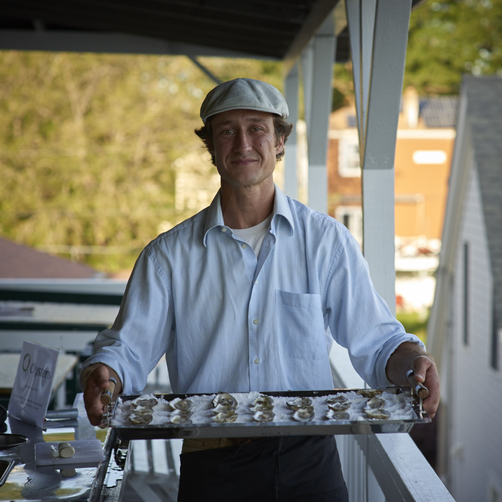 Lucas Myers and his mobile shucking station bring O'Oysters to the Village during the Wiscasset Art Walk on Thursday, Aug. 31.