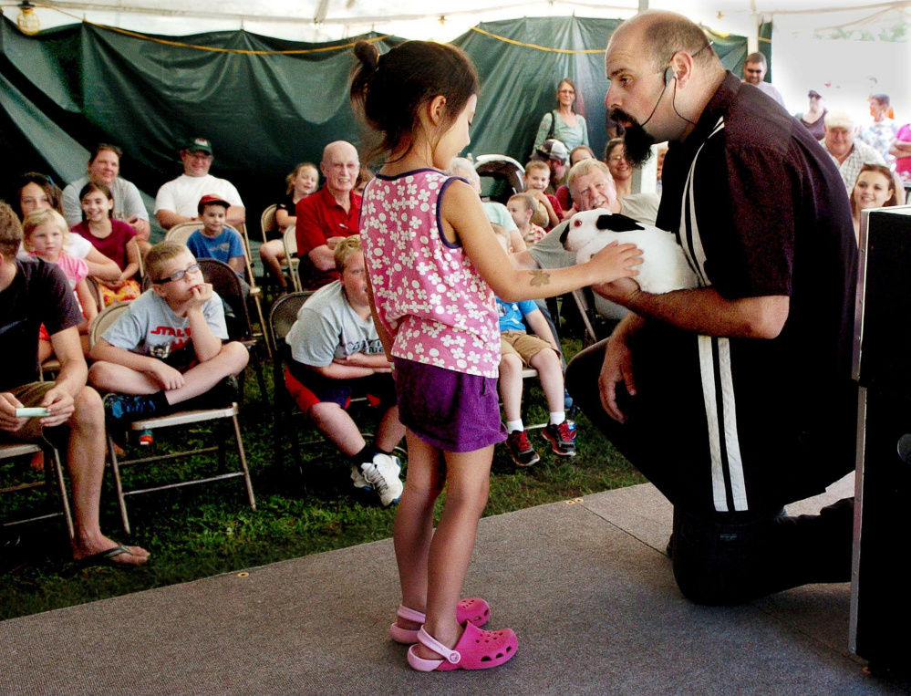 HARMONY,  ME-  September 4: June Noyes pets the live rabbit that magician Conjuring Carroll pulled  out of a box after June used a magic wand during a magic show at the Harmony Free Fair on Sunday, September 4, 2016.  (Photo by David Leaming/Staff Photographer)