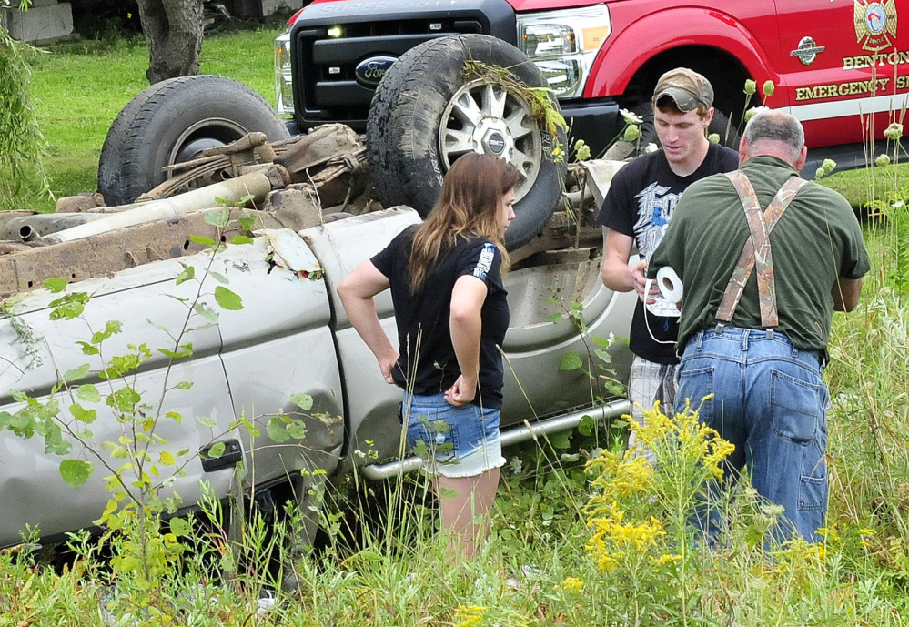 Benton homeowners Lisa Jordan and Dylan Ellis, center, and another man were first on the scene where a vehicle went off the Albion Road in Benton with two occupants who were injured on Tuesday.