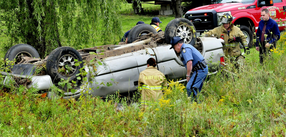 State Police and Fairfield firefighters arrive to assist injured occupants of a vehicle that lost control and went off the Albion Road in Benton on Tuesday.