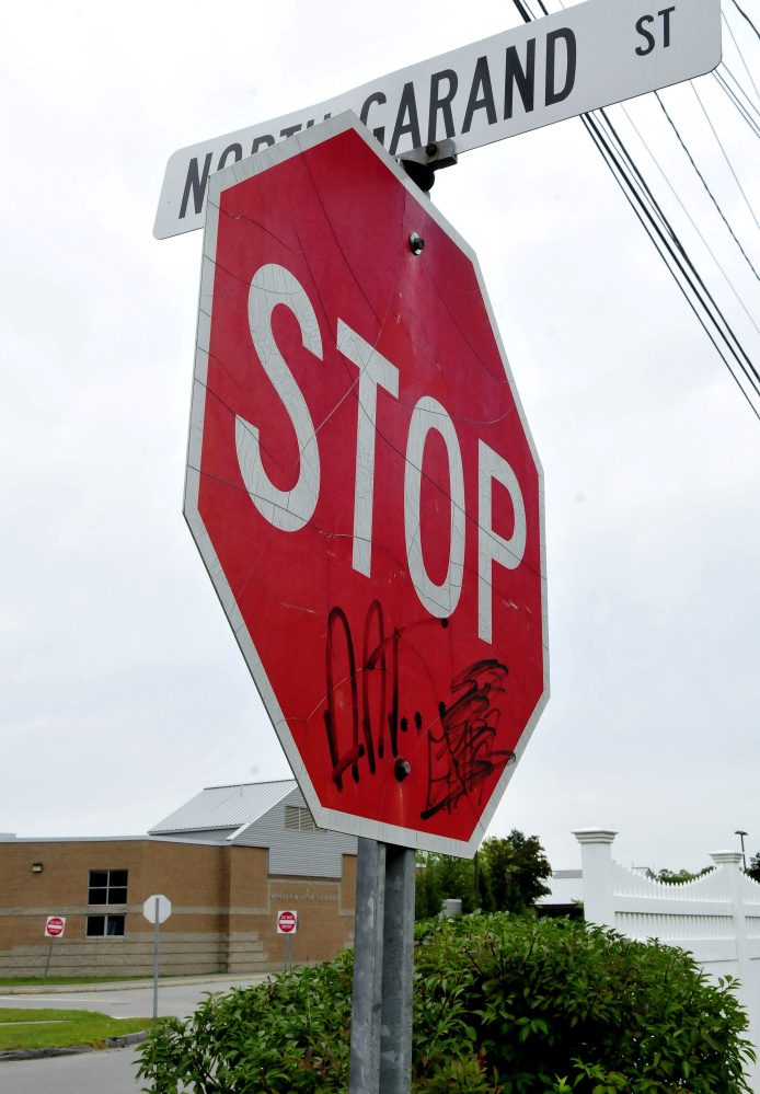 Graffiti mars a stop sign Wednesday at the end of North Garand Street near Winslow High School.