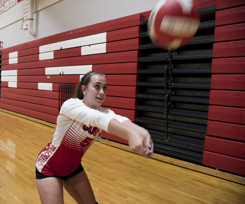 Cony volleyball player Sarah Caron practices before a scrimmage against Brewer on Monday night in Augusta.