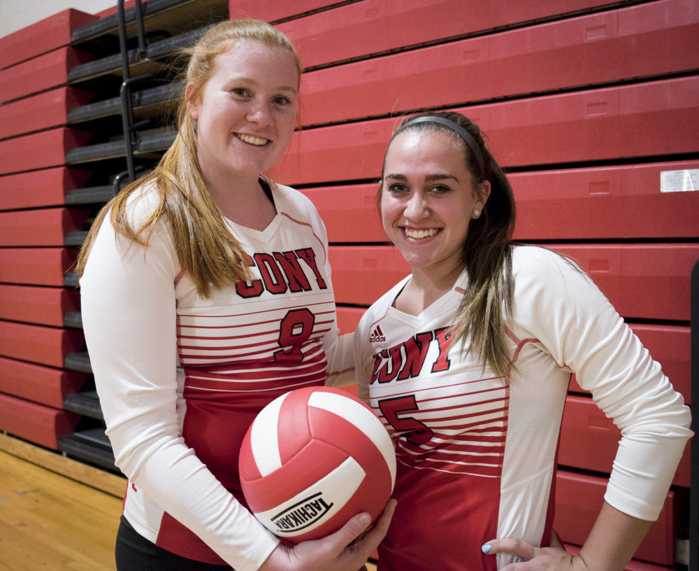 Cony volleyball players Lauren Coniff, left, and Sarah Caron pose before a scrimmage Monday night against Brewer in Augusta. Coniff and Caron have played for a Portland-area travel team each of the past two winters