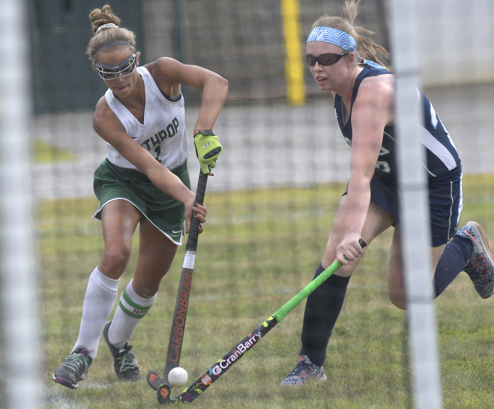 Winthrop forward Kinli DiBiasi, left, drives past Dirigo defender Devon Fletcher during a field hockey game Wednesday in Winthrop. The Ramblers won, 2-1.