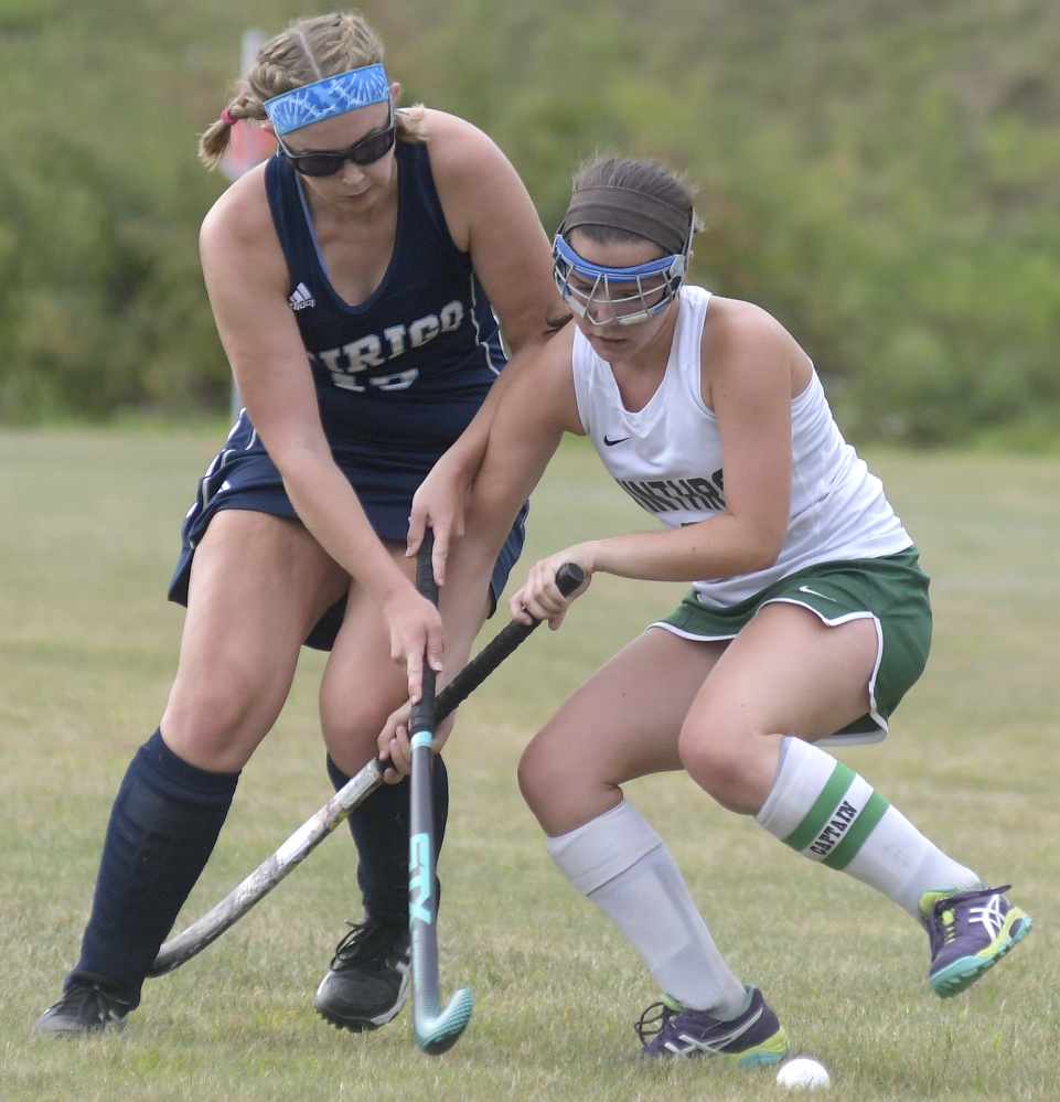 Winthrop's Moriah Hajduk, right, collides with Dirigo's Alexa Farnum during a field hockey game Wednesday in Winthrop. The Ramblers won, 2-1.
