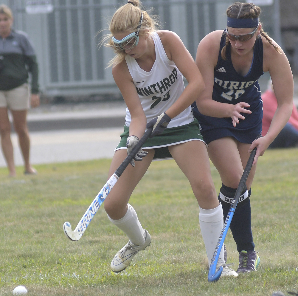Winthrop High School's Bry Baxter, left, collides with Dirigo defender Ashley Walker during a field hockey game Wednesday in Winthrop.