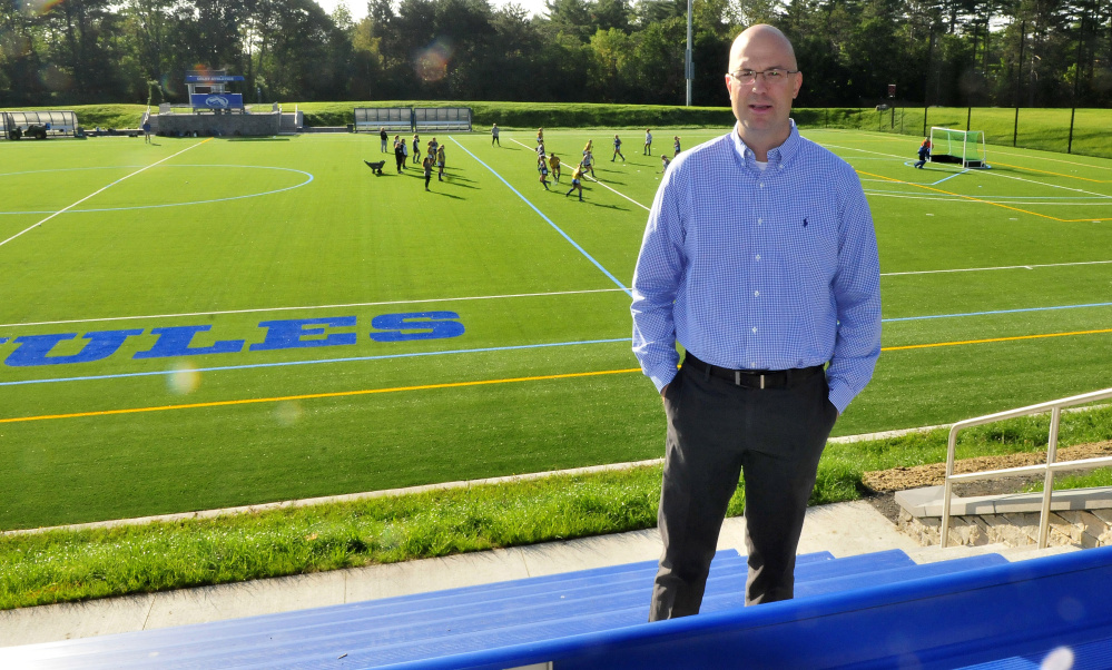 Colby College athletic director Jake Olkkola talks about the new school athletic fields, including the field hockey field, Thursday morning.
